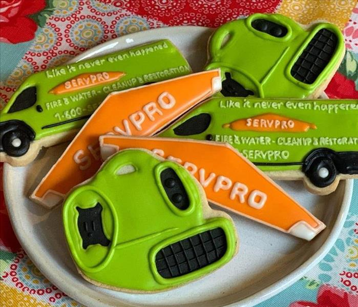 Frosted covered sugar cookies of SERVPRO equipment and vehicle.
