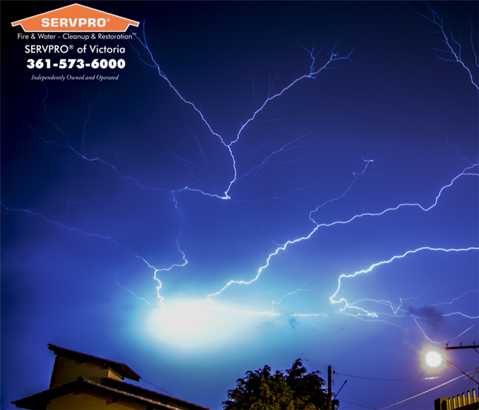 Night time skies with major lightning storm.  SERVPRO of Victoria logo and company information in the top left hand corner.