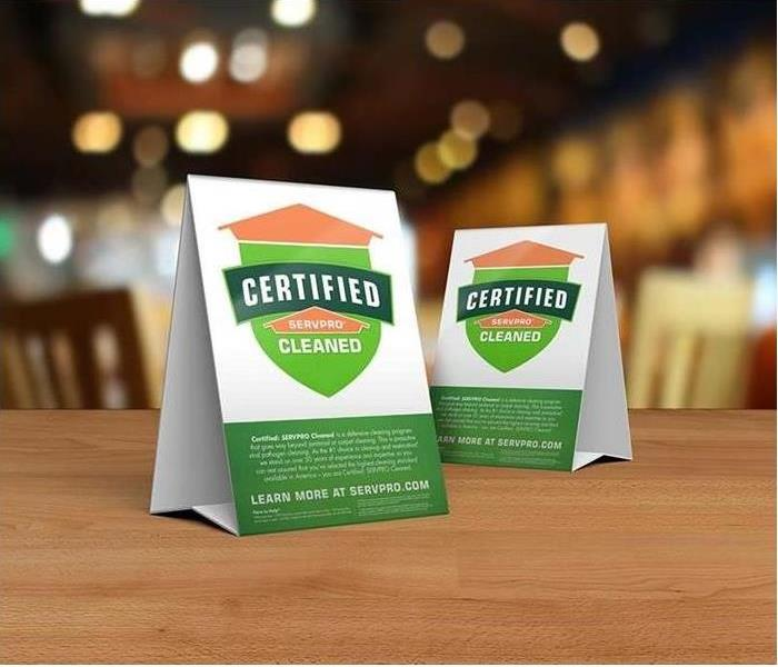Table tent signs describing the Certified: SERVPRO Cleaned program